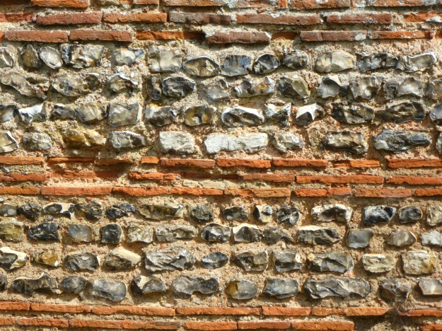 Flint and brick banding on the west wall of Burgh Castle Roman Fort, Norfolk